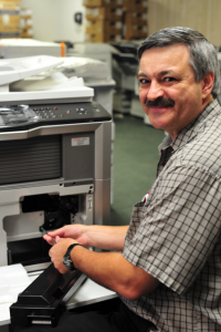 man fixing copier